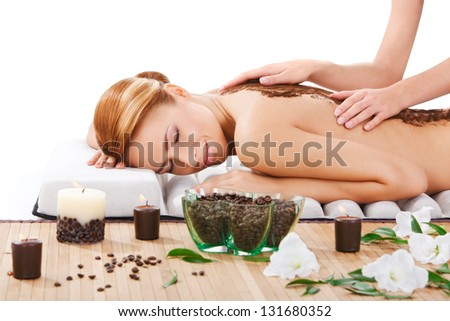 closeup portrait of beautiful young woman getting back massage at spa