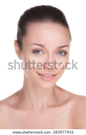 closeup portrait of beauty woman with clean fresh skin isolated over white
