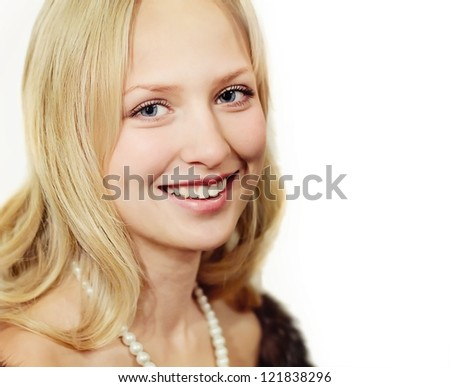 Closeup portrait of blonde woman with pearls - stock photo