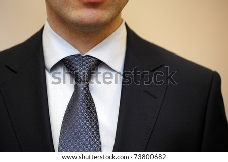 Closeup portrait of businessman in white collar shirt and suit with tie. - stock photo