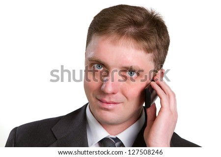 Closeup portrait of casual businessman talking on mobile phone. Isolated on white - stock photo