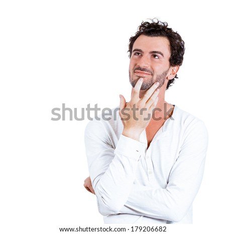 Closeup portrait of charming upbeat smiling joyful happy young man looking upwards with hands on chin daydreaming, isolated on white background. Positive emotion facial expression feelings, attitude - stock photo