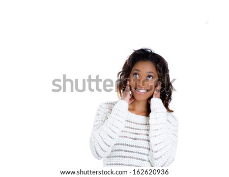 Closeup portrait of charming upbeat smiling joyful happy young woman looking upwards with hands on cheeks daydreaming, isolated on white background copy space. Positive human emotion facial expression - stock photo