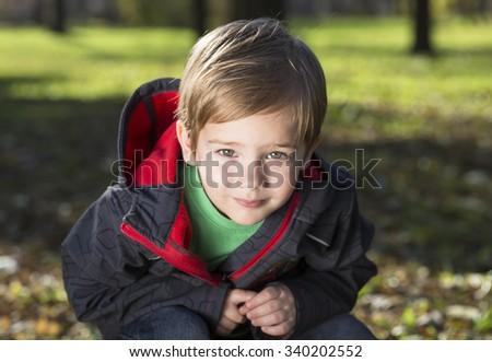 closeup portrait of child boy in autumn in a park - stock photo