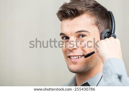 Closeup portrait of confident male customer service representative speaking with costumer - stock photo