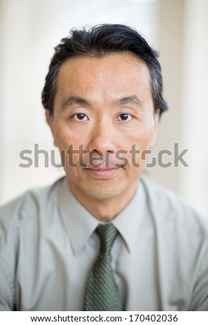 Closeup portrait of confident mature cancer specialist in hospital - stock photo