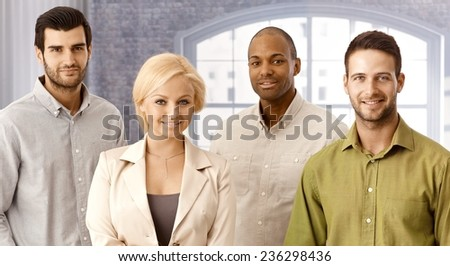 Closeup portrait of confident young businesspeople, smiling, looking at camera. - stock photo