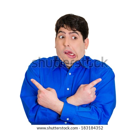 Closeup portrait of confused young man pointing in two different directions, not sure which way to go in life, isolated on white background. Negative emotions, facial expressions, feelings, dilemma