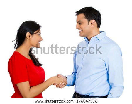 Closeup portrait of couple, man woman shaking hands after conflict resolution and finding solution to a problem, isolated on white background with. Positive human emotion facial expression feelings.. - stock photo