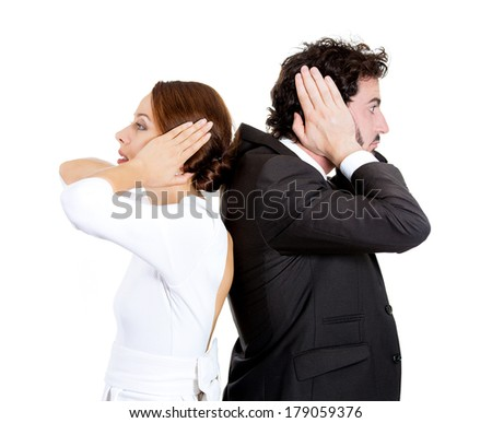 Closeup portrait of couple, man, woman standing with backs together, covering ears, opened eyes, not listening to each other isolated on white background. Negative human emotions, facial expressions. - stock photo
