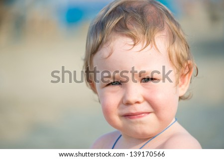 Closeup portrait of cute baby boy outdoor