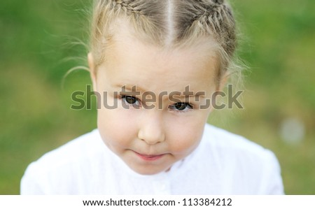 Closeup portrait of cute little blond girl - stock photo