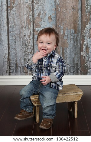 Closeup portrait of cute little boy laughing - stock photo