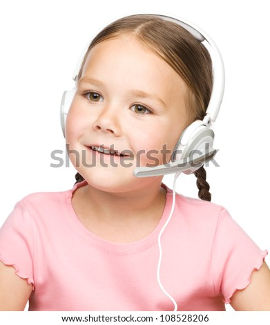 Closeup portrait of cute little girl talking to customers as a consultant using headset, isolated over white - stock photo