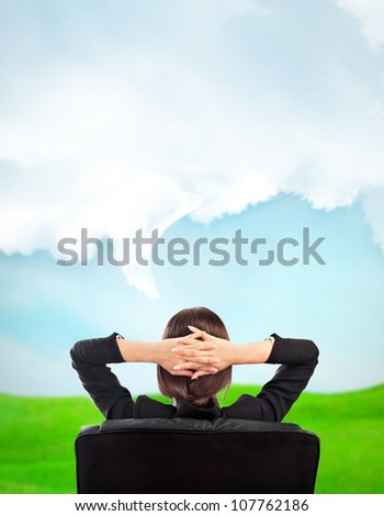 Closeup portrait of cute young business woman from behind dreaming, resting and imagine idyllic view. Blank cloud with lots of copyspace overhead - stock photo