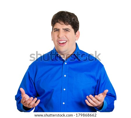 Closeup portrait of dumb, clueless, funny looking young man, arms out asking what's problem, who cares, so what, I don't know, isolated on white background. Negative human emotions, facial expressions - stock photo