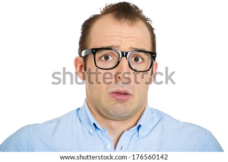 Closeup portrait of dumb clueless young business man, lost funny looking guy with what's the problem, I don't know on face, feeling embarrassed isolated on white background. Human emotion, expression - stock photo