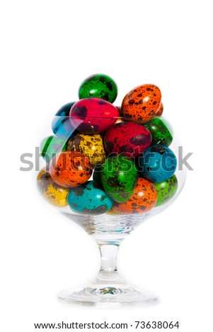 Closeup portrait of Easter colorful eggs in glass