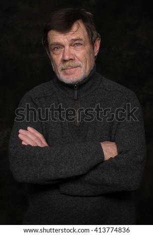 Closeup portrait of elderly man with beard on a black background - stock photo