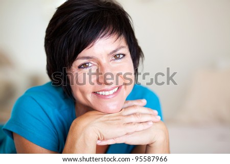 closeup portrait of elegant middle aged woman - stock photo