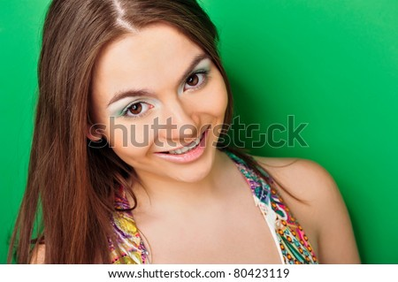 Closeup portrait of excited student  woman on green background. - stock photo