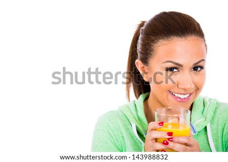 Closeup portrait of female holding glass of orange juice, isolated on white background - stock photo