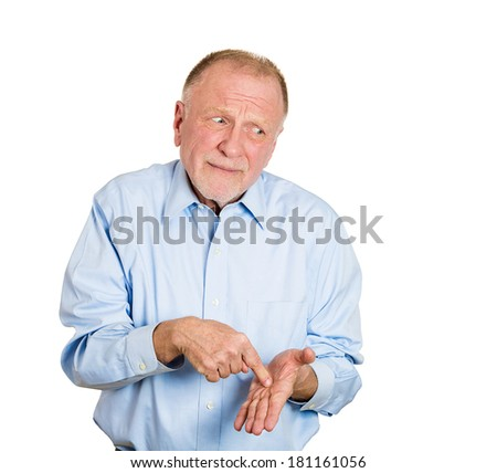 Closeup portrait of funny looking guy, senior mature business man with finger to hand sign showing feeling guilty sorry for actions faults he did wrong, isolated white background. Expression, emotion - stock photo