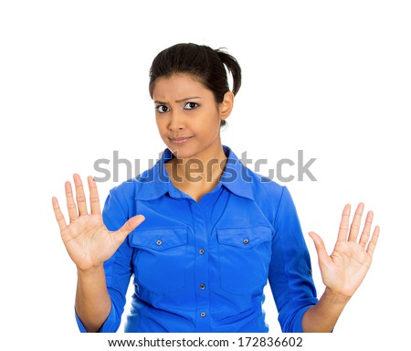 Closeup portrait of furious mad angry annoyed displeased young woman raising hands up to say no, stop right there, isolated on white background. Negative human emotion facial expression sign symbol - stock photo