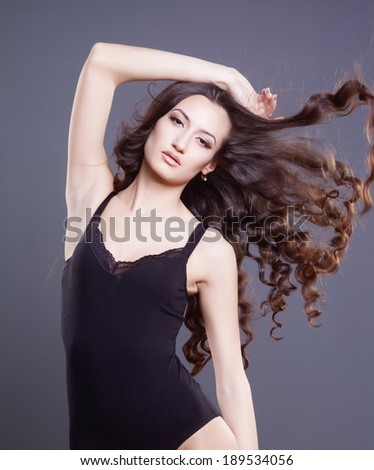 closeup portrait of glamour young girl with beautiful long curly hair