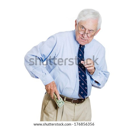 Closeup portrait of greedy senior executive, CEO, boss, old corporate employee, business man, holding dollar banknotes tightly, hiding, possessive, isolated on white background. Negative human emotion