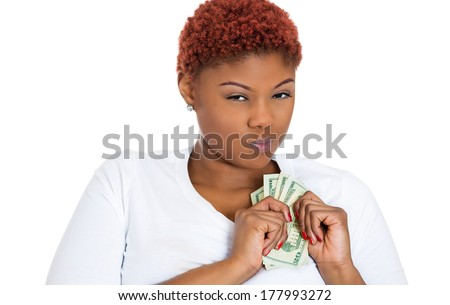 Closeup portrait of greedy young woman corporate business employee, worker, student holding dollar banknotes tightly, isolated on white background. Negative human emotion facial expression feeling - stock photo