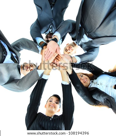 Closeup portrait of group of business people with hands together - stock photo