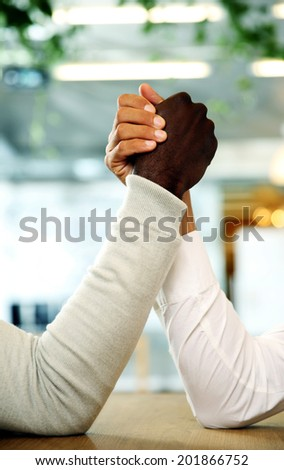 Closeup portrait of hands grappled in fight - stock photo