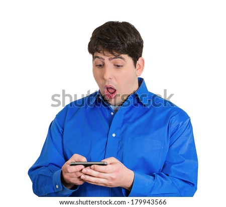 Closeup portrait of handsome funny young man, shocked surprised, wide open mouth, eyes, by what he sees on his cell phone, isolated white background. Negative human emotions, facial expression feeling - stock photo