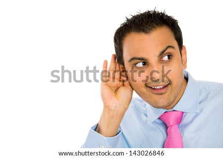 Closeup portrait of handsome guy with blue shirt and pink tie trying to secretly listen in on a conversation, privacy violation, isolated on white background with copy space - stock photo