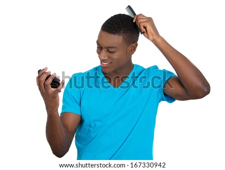 Closeup portrait of handsome haughty arrogant young man admiring himself in the mirror combing his hair smiling, isolated on white background. Negative human emotion facial expressions feeling - stock photo