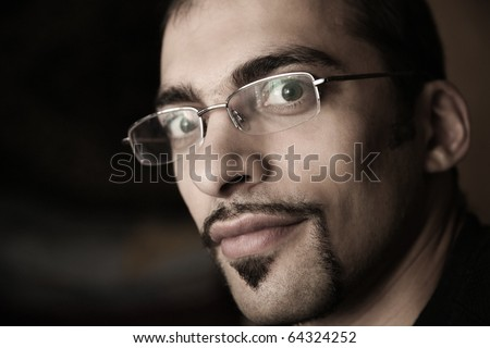 Closeup portrait of handsome male face in glasses with cool mustache and goatee.