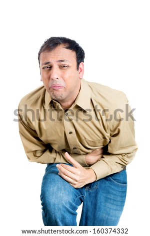 Closeup portrait of handsome, miserable, upset, young guy, doubling over in stomach pain, looking very sick, isolated on white background with copy space. Human facial expressions and emotions, health - stock photo