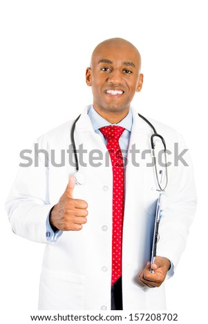 Closeup portrait of handsome smiling male healthcare professional, doctor or nurse holding clipboard and giving a thumbs up sign, isolated on white background. Patient care and annual visit, check up - stock photo