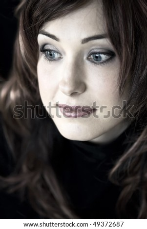 Closeup Portrait of handsome woman with blue eyes looking to the side
