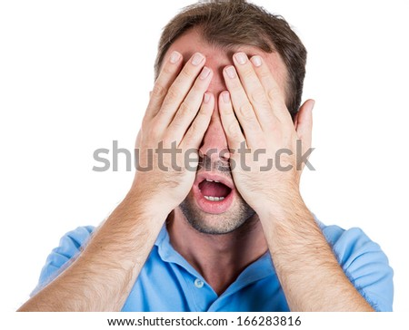 Closeup portrait of handsome young man closing eyes with hands can't see and hiding mouth wide open, isolated on white background. See no evil concept. Negative emotion facial expression feelings - stock photo