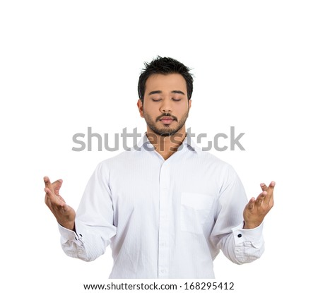 Closeup portrait of handsome, young man in meditation zen mode, isolated on white background. Stress relief techniques concept. Positive human emotions and facial expression feelings - stock photo