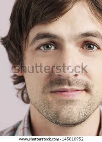 Closeup portrait of handsome young man isolated on colored background