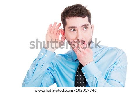 Closeup portrait of handsome, young, nosy man trying to secretly listen in on conversation, hand to mouth, surprised excited, juicy gossip he is hearing, privacy violation isolated on white background - stock photo