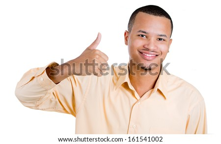 Closeup portrait of handsome young smiling man giving one thumbs up at you camera gesture isolated on white background with copy space. Positive human emotions, signs, facial expressions. - stock photo