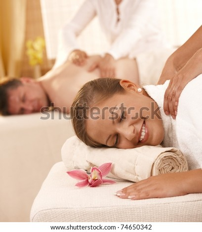 Closeup portrait of happy couple having back massage in day spa.? - stock photo