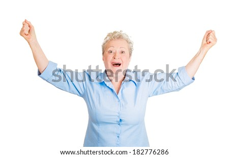 Closeup portrait of happy, cute, senior mature woman shocked, surprised, in full disbelief hands in air, isolated white background. Positive human emotion, facial expression, feeling, reaction - stock photo