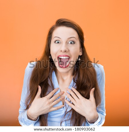 Closeup portrait of happy cute young beautiful woman looking excited, surprised in full disbelief, hands on chest, it's me? isolated orange, red background. Positive human emotions,facial expressions - stock photo