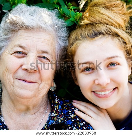 Closeup portrait of happy grandmother and grand daughter - stock photo