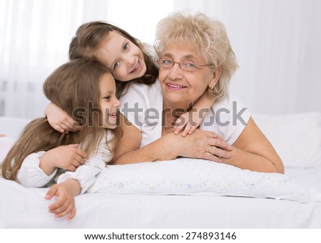 Closeup  portrait of happy grandmother with grandchildren
